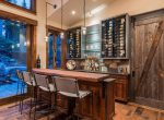 Wine Bar in Ski-On/Ski-Out Custom Family Lodge in Northstar by Borelli Architecture